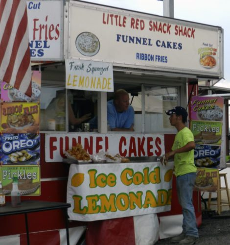 A customer stops by the Little Red Snack Shack at the fair to order food. Kaley Toy/Daily